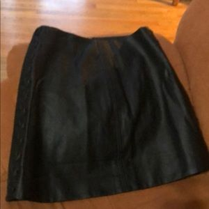Black faux leather skirt with side lacing detail